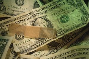 Dollar with a bandage on it