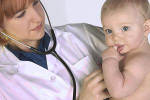Health professional examining a young patient.